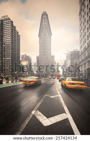 NEW YORK CITY, USA, January 2014 - Historic Flatiron Building in NYC as seen on January 18, 2014. The building located between Broadway, Manhattan Fifth Ave. - stock photo