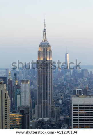 New York City, USA - July 12, 2015: Empire State Building and Manhattan Cityscape at Dusk with Freedom Tower on background. The Empire State Building is the American cultural icon in New York City. - stock photo