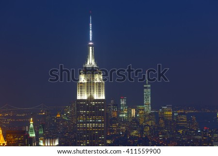 New York City, USA - July 12, 2015: Empire State Building and Manhattan Cityscape by night with Freedom Tower on background. The Empire State Building is the American cultural icon in New York City.