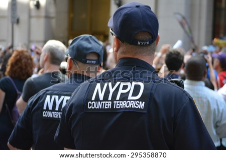 New York City, USA - July 10, 2015: Members of the NYPD protecting the crowd at the  Women's World Cup championship victory parade in New York City.