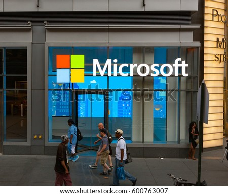 New York City, Usa - July 08, 2015: Pedestrians walk past the corporate offices of Microsoft in Manhattan. Microsoft is an American technology company.