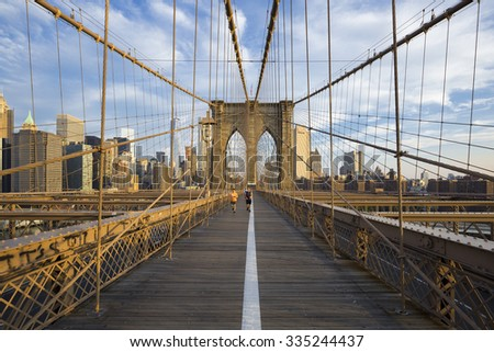 New York City, USA, - July. 11. 2015: Runners commuting to Manhattan over Brooklyn Bridge. New York, USA