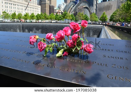 NEW YORK CITY, USA - June 2, 2014: Flowers left at the National 9/11 Memorial at Ground Zero in Lower Manhattan.  - stock photo