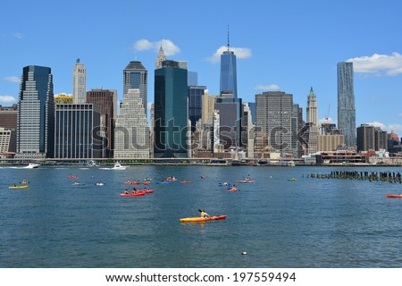 NEW YORK CITY, USA - June 6, 2014: People kayaking on the East River with the Lower Manhattan skyline in the background.  - stock photo