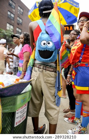 NEW YORK CITY, USA - JUNE 30, 2013: Revelers take to the streets in colorful costumes during the annual Gay Pride parade in Greenwich Village. - stock photo