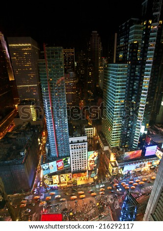 NEW YORK CITY, USA - JUNE 29th, 2014: Aerial view of Times Square the popular New Year's Eve destination with crowds and taxi cabs in motion in New York City