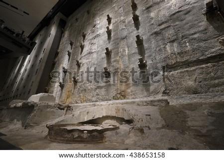 NEW YORK CITY, USA - JUNE 08 2016 - The Last Column Remnants and Slurry Wall in the National 9/11 Memorial Museum at Ground Zero in Lower Manhattan, New York City, USA - stock photo