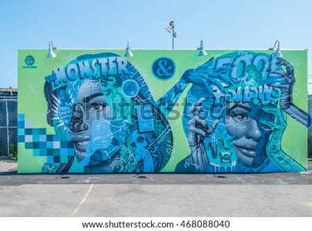 "NEW YORK CITY, USA - JUNE 25, 2016: ""The Monster Within & The Fool That Follows"", wall project by Tristan Eaton, Coney Art Walls, the outdoor museum of street art"