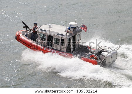 NEW YORK CITY, USA - JUNE 10: U.S. Coast Guard patrol boat on Upper New York Bay. June 10, 2012 in New York City, USA - stock photo
