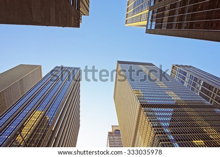 NEW YORK CITY, USA - MAY 7, 2015: Bottom up view of skyscrapers in the financial district of New York City, USA             - stock photo