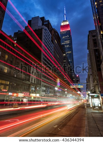 NEW YORK CITY, USA - May 28, 2016: Empire State Building, in red, white and blue colors at night is a draw to New York tourism and is an iconic building of New York and America.