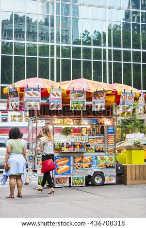 NEW YORK CITY, USA - May 28, 2016: Famous New York food cart that can be found on most major pedestrian routes in the midtown area of manhattan. - stock photo