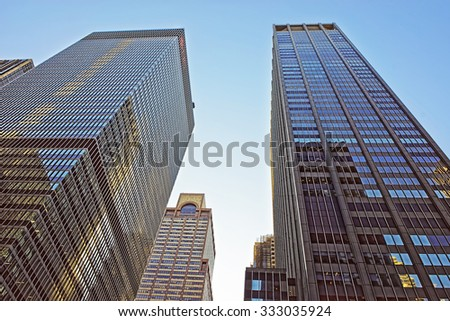 NEW YORK CITY, USA - MAY 7, 2015: High modern skyscrapers rising up to deep blue sky in New York City, USA             - stock photo
