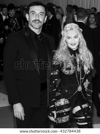 New York City, USA - May 2, 2016: Riccardo Tisci (L) and Madonna attend the Manus x Machina Fashion in an Age of Technology Costume Institute Gala at the Metropolitan Museum of Art