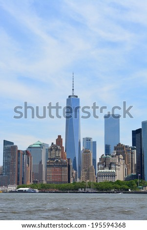 NEW YORK CITY, USA - May 26, 2014: World Trade Center Tower One rising over Lower Manhattan as viewed from New York Harbor. - stock photo
