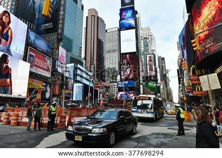 NEW YORK CITY, USA - NOV 11, 2015: Traffic and people make their through Times Square in downtown Manhattan.