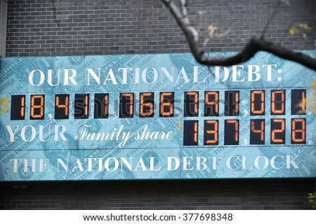 NEW YORK CITY, USA - NOV 11, 2015: View of the National Debt Clock on a downtown Manhattan street. The clock shows gross national debt and each family's share of that debt. - stock photo