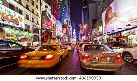 NEW YORK CITY, USA - Nov 13, 2011: Yellow cabs and traffic with colorful signage in Times Square and 42nd Street in New York City. - stock photo
