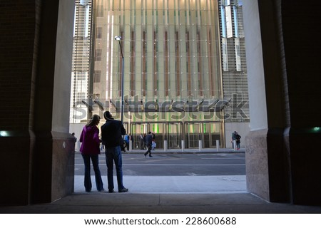 New York City, USA - November 3, 2014: A couple across the street from the newly opened World Trade Center Tower One in New York City.  - stock photo