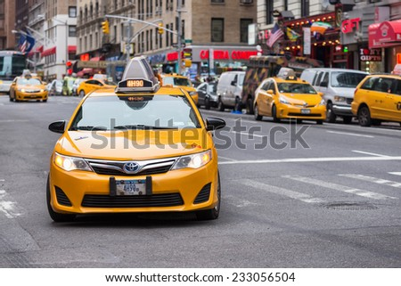 NEW YORK CITY, USA - NOVEMBER 16, 2014 : A taxi cab of New York City with some more cabs on the background.  - stock photo