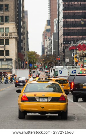 NEW YORK CITY, USA - NOVEMBER 16, 2014 : Back view of a  taxi cab in New York City streets with traffic jam and skyscrapers around. - stock photo