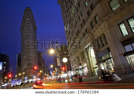 New York City, USA - November 23, 2013: Flatiron Building with traffic at night. It is located at 175 Fifth Avenue in the borough of Manhattan, New York City.  - stock photo