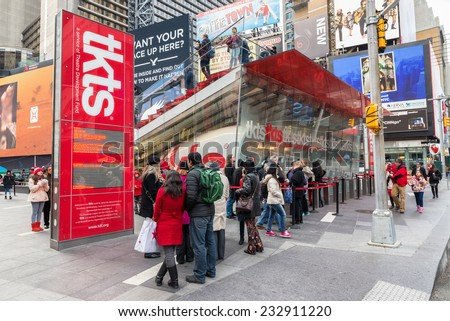 NEW YORK CITY, USA - NOVEMBER 20, 2014 : People buying ticket and looking for shows in TKTS discount ticket booth for Broadway shows of Theatre Devolopment Fund in Times Square New York City. - stock photo
