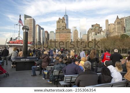 New York City, USA - November 4: People on a ferry to Lower Manhattan in New York City, USA on November 4, 2014. - stock photo
