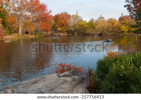 NEW YORK CITY, USA - NOVEMBER 14: People row in recreational boats on a lake in Central Park at November 14, 2011.