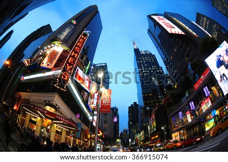 NEW YORK CITY, USA - OCT 10: Times Square crowds and traffic at night through fisheye lens. The site is regarded as the world's most visited tourist attraction. MYC Oct 10, 2014 - stock photo