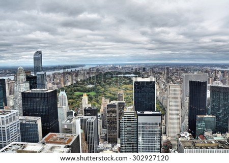 NEW YORK CITY, USA - OCTOBER 24, 2014: Aerial view on Central Park and midtown Manhattan on a cloudy day. Central Park is the most visited urban park in the United States - stock photo