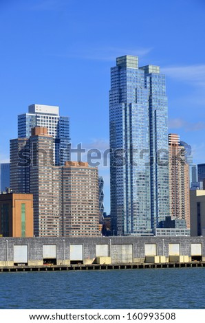 NEW YORK CITY USA OCTOBER 29; Manhattan midtown apartement skyline panorama over East River with urban skyscrapers. On october 29 2013 in New York USA - stock photo