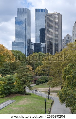 NEW YORK CITY, USA - OCTOBER 25: New York City Manhattan skyline panorama viewed from Central Park with cloud and blue sky and people in lawn on October 25, 2013. in New York City. - stock photo