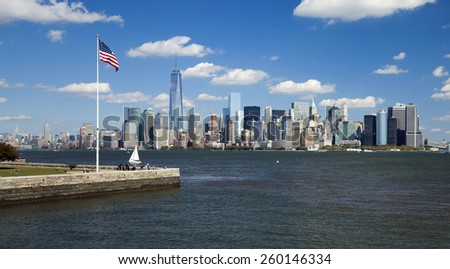 NEW YORK CITY, USA - OCTOBER 8, 2014: New York panorama, One World Trade Center (formerly known as the Freedom Tower) and Ellis Island. Freedom Tower is shown finished with antenna. - stock photo