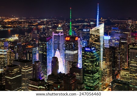 NEW YORK CITY, USA - OCTOBER 5, 2014: New York Uptown and Times Square panorama aerial view at night with office building, neon, LED Signs and skyscrapers skyline. - stock photo