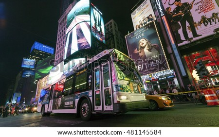 NEW YORK CITY, USA-OCTOBER 4:Times Square, featured with Theaters, Sightseeing Buses, Taxi Cabs and animated LED signs, is a symbol of New York. Taken in Manhattan, New York City on October 4, 2014