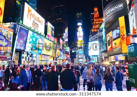 New York City, USA - October 9, 2013: View of Times Square with lots of visitors at night in New York City on October 9, 2013.