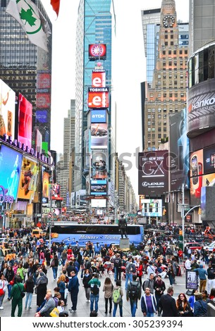 New York City, USA - October 9, 2013: View of Times Square with lots of visitors in New York City on October 9, 2013.