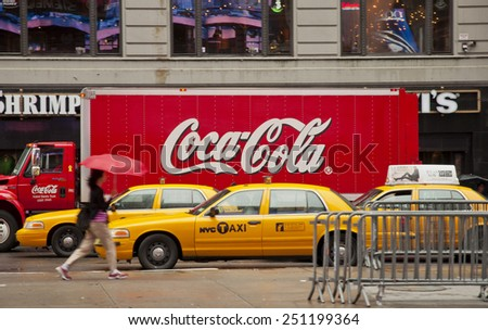 NEW YORK CITY, USA - SEPTEMBER 7: Coca Cola Truck and Yellow Cabs in the streets of New York City. New York City, USA sept 7 2011 - stock photo