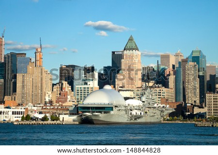 NEW YORK CITY, USA - SEPTEMBER 24: New York Intrepid Sea, Air and Space Museum on September 24, 2012. It is one of Americas leading educational institutions and is centered on the aircraft carrier. - stock photo