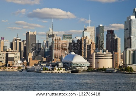 NEW YORK CITY, USA - SEPTEMBER 24: New York Uptown and Intrepid Sea, Air and Space Museum on September 24, 2012. It is one of America`s leading educational institutions and is opened since1982. - stock photo