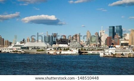 NEW YORK CITY, USA - SEPTEMBER 24: New York Uptown and Intrepid Sea, Air and Space Museum on September 24, 2012. It is one of America`s leading educational institutions and is opened since 1982. - stock photo
