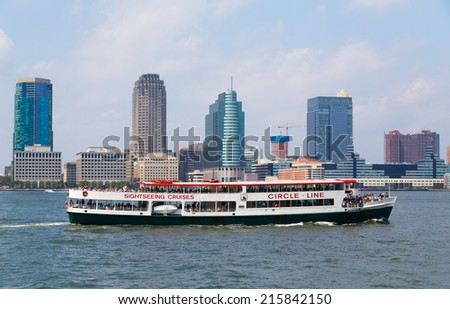 NEW YORK CITY, USA - 31ST AUGUST 2014: A Circle Line Sightseeing Cruise on the Hudson River in New York City. People can be seen on the boat - stock photo