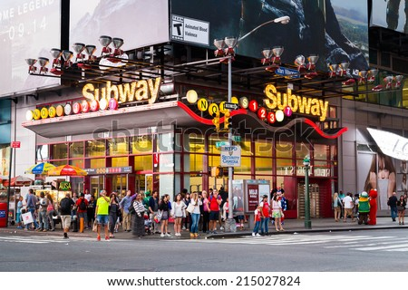 NEW YORK CITY, USA - 30TH AUGUST 2014: A subway stop along 42nd Street near the Theatre Disrict. Showing large amounts of people outside the entrance