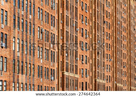 New York City wall of apartment building windows background texture - stock photo