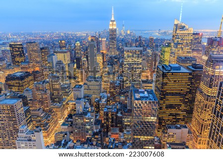 New York City with skyscrapers at sunset - stock photo