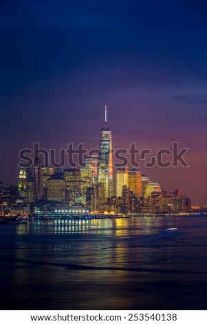 New York City with skyscrapers illuminated over Hudson River panorama. - stock photo