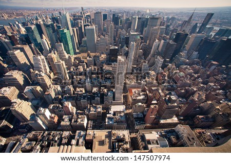 new york cityscape viewed from top of empire state building. - stock photo