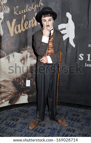 NEW YORK - Dec 6: A wax figure of Charlie Chaplin is seen on display at Madame Tussauds on December 6, 2013 in New York City. - stock photo