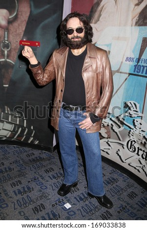 NEW YORK - Dec 6: A wax figure of Jerry Garcia is seen on display at Madame Tussauds on December 6, 2013 in New York City. - stock photo